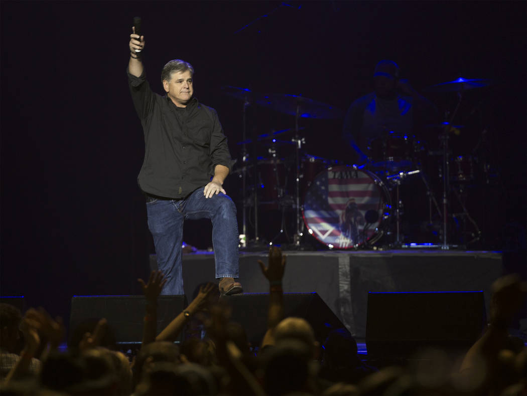 """Conservative political commentator Sean Hannity addresses the crowd during ''Vegas Strong: A Night of Healing"""", a benefit concert on Thursday, October 19, 2017, at The Orleans Arena, in Las Vegas, ..."""