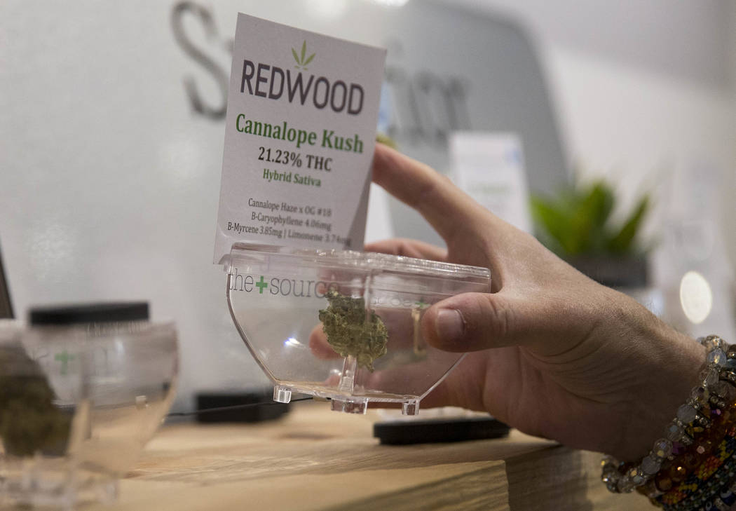 Las Vegas resident Kris Counts samples the cannabis on display before making a purchase at The Source cannabis dispensary in Henderson on Friday, Oct. 20, 2017. Richard Brian Las Vegas Review-Jour ...