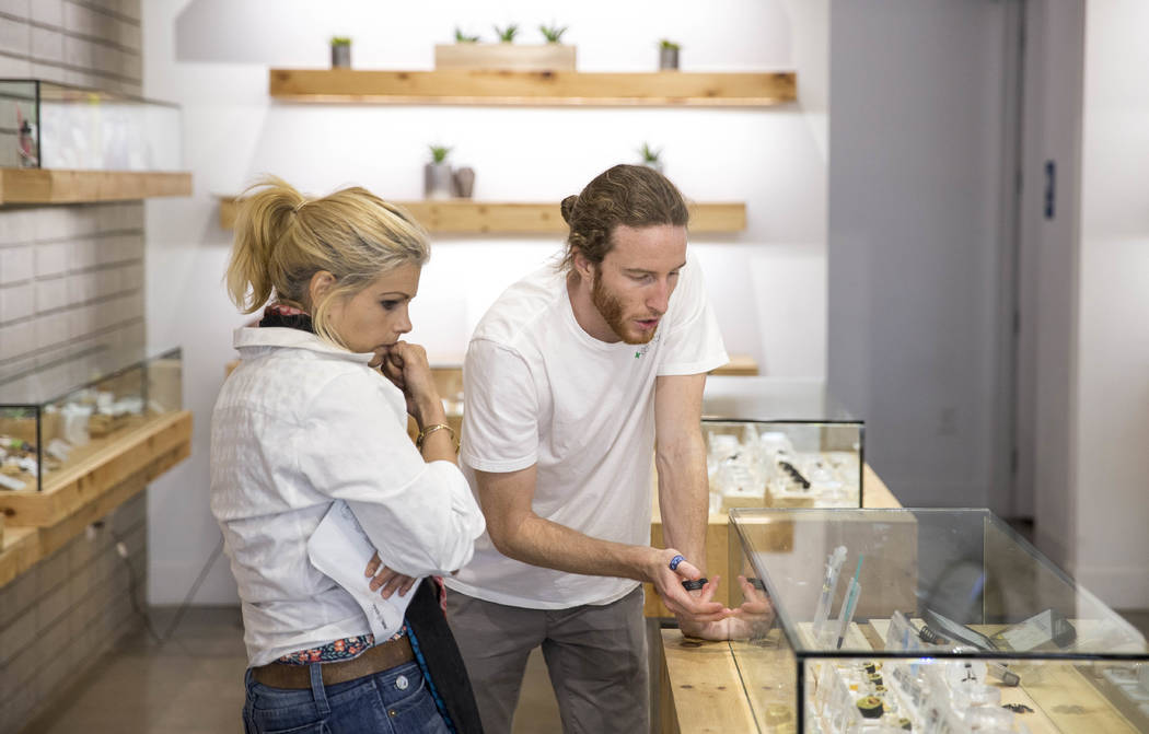 Patient advisor Regan Fuget, right, helps Henderson resident Francesca Curtice with her concentrate selection while shopping at The Source cannabis dispensary in Henderson on Friday, Oct. 20, 2017 ...