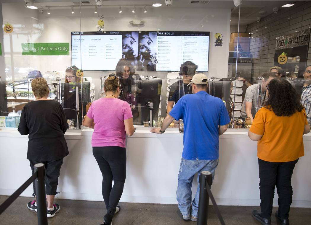 Customers make their purchases at The Source cannabis dispensary in Henderson on Friday, Oct. 20, 2017. Richard Brian Las Vegas Review-Journal @vegasphotograph