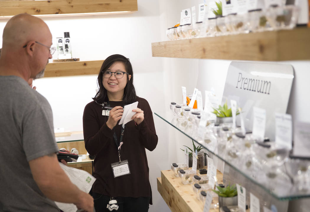 Lead floor advisor Sue Chung helps customers at The Source cannabis dispensary in Henderson on Friday, Oct. 20, 2017. Richard Brian Las Vegas Review-Journal @vegasphotograph