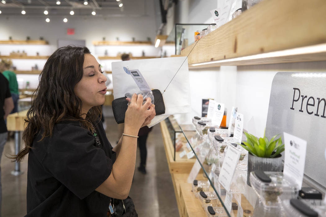 Las Vegas resident Lil Farias enjoys the scent of cannabis on display while shopping at The Source cannabis dispensary in Henderson on Friday, Oct. 20, 2017. Richard Brian Las Vegas Review-Journal ...