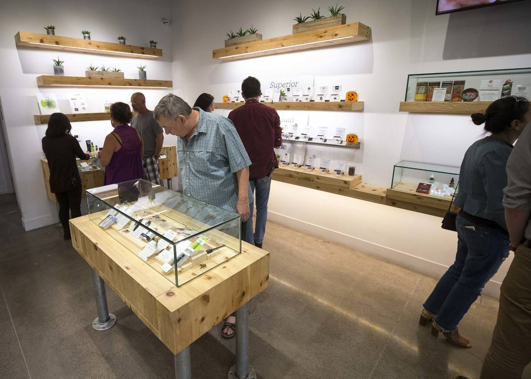 Customers browse the cannabis choices on display at The Source cannabis dispensary in Henderson on Friday, Oct. 20, 2017. Richard Brian Las Vegas Review-Journal @vegasphotograph