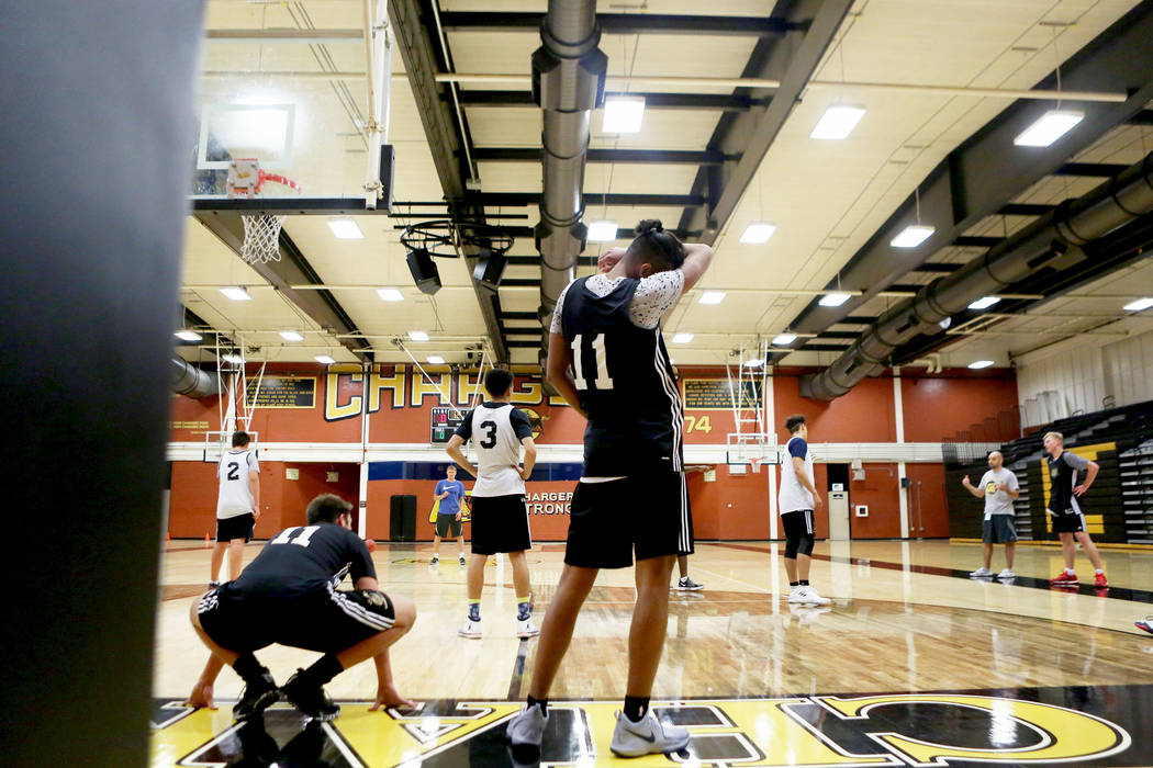 Clark High School senior Greg Foster, center, wipes his face during basketball practice at Clark High School in Las Vegas, Monday Oct. 23, 2017. Elizabeth Brumley Las Vegas Review-Journal @EliPage ...