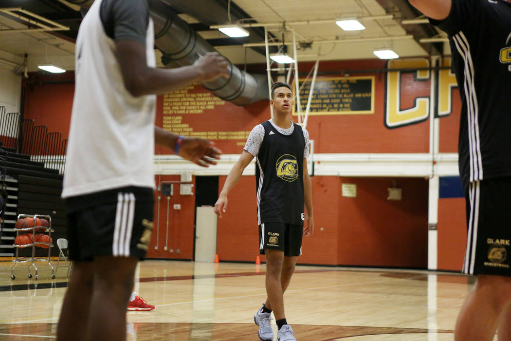 Clark High School senior Greg Foster, center, finishes a drill  during basketball practice at Clark High School in Las Vegas, Monday Oct. 23, 2017. Elizabeth Brumley Las Vegas Review-Journal @EliP ...