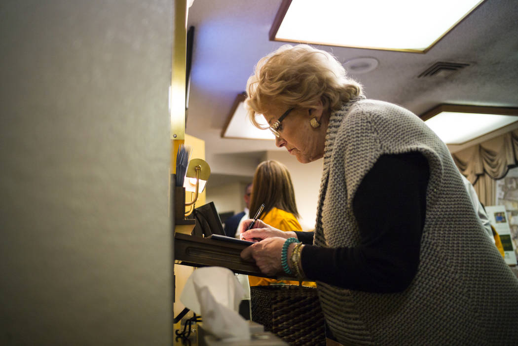 Las Vegas Mayor Carolyn Goodman signs a guestbook during a memorial service for Erick Silva at Davis Funeral Home in Las Vegas on Wednesday, Oct. 11, 2017. Silva was working as a security guard at ...
