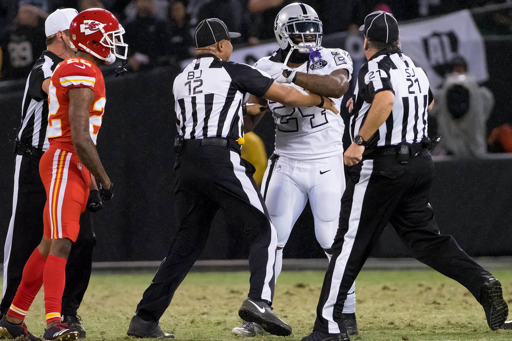 Oct 19, 2017; Oakland, CA, USA; Oakland Raiders running back Marshawn Lynch (24) in an altercation with the referees during the second quarter against the Kansas City Chiefs at Oakland Coliseum. ( ...
