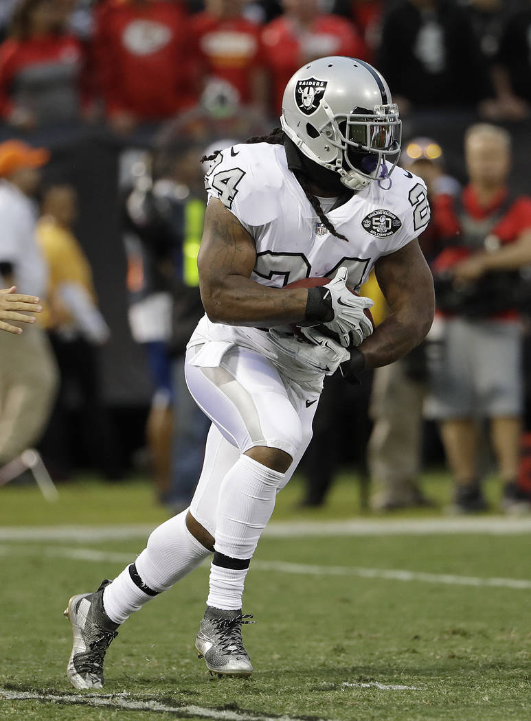 Oakland Raiders running back Marshawn Lynch (24) runs against the Kansas City Chiefs during the first half of an NFL football game in Oakland, Calif., Thursday, Oct. 19, 2017. (AP Photo/Marcio Jos ...