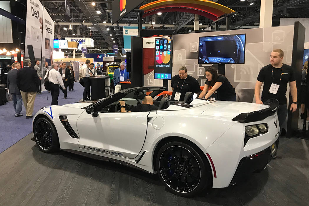 Mastercard's booth at the Money 20/20 conference on Monday, Oct. 23, 2017, in Las Vegas, Nev., included a car to demonstrate its in-car payment software. Todd Prince/Review-Journal