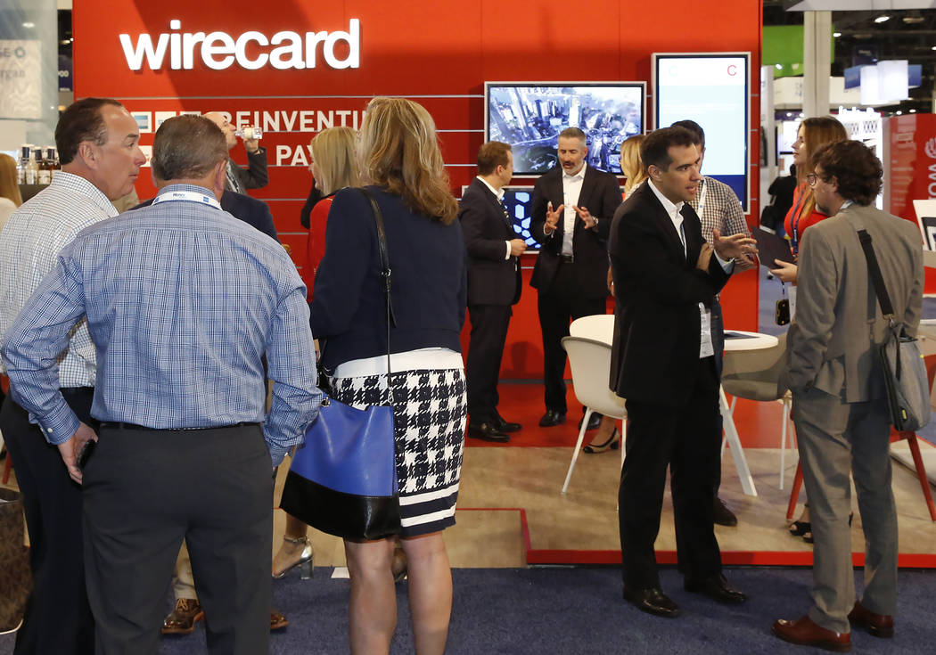 Attendees gather at wildcard booth during the 2017 Money 20/20 conference at the Sands Expo and Convention Center Monday, Oct. 23, 2017, in Las Vegas. Bizuayehu Tesfaye Las Vegas Review-Journal @b ...