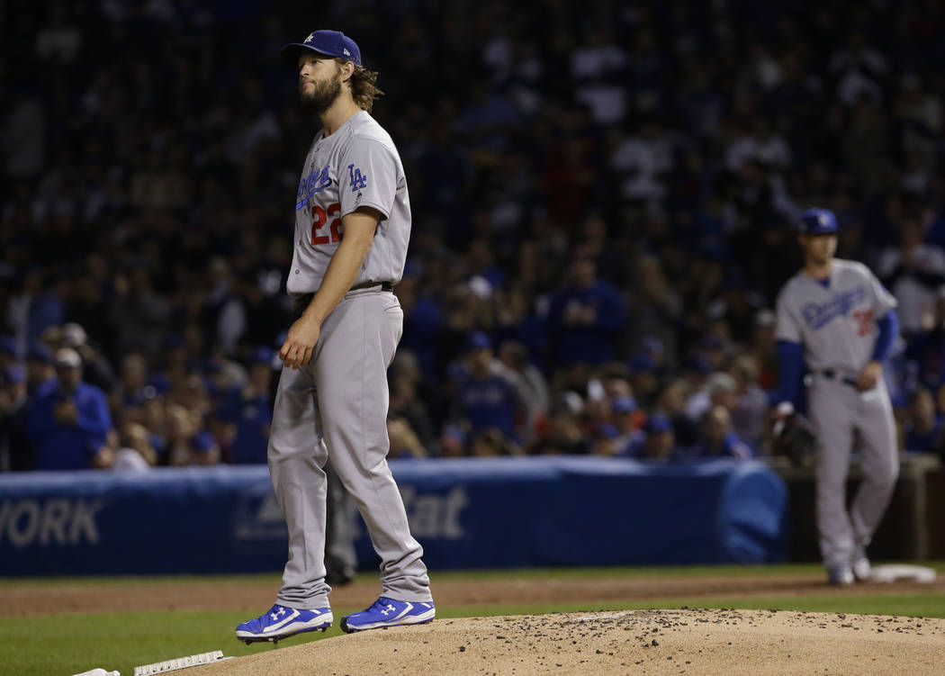 Los Angeles Dodgers starting pitcher Clayton Kershaw reacts after walking Chicago Cubs' Kyle Schwarber during the first inning of Game 5 of baseball's National League Championship Series, Thursday ...