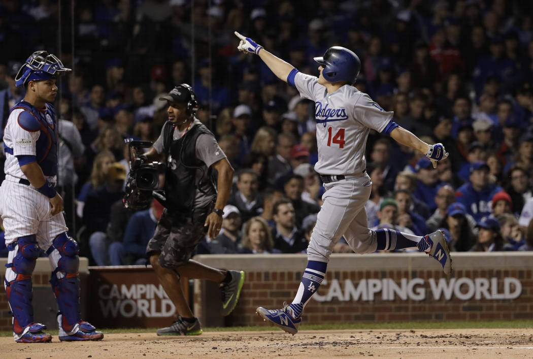 Los Angeles Dodgers' Enrique Hernandez (14) reacts after hitting a home run during the second inning of Game 5 of baseball's National League Championship Series against the Chicago Cubs, Thursday, ...