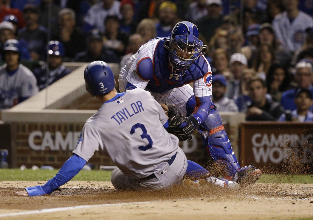 Chicago Cubs catcher Willson Contreras tags out Los Angeles Dodgers' Chris Taylor (3) at home plate during the fourth inning of Game 5 of baseball's National League Championship Series, Thursday,  ...