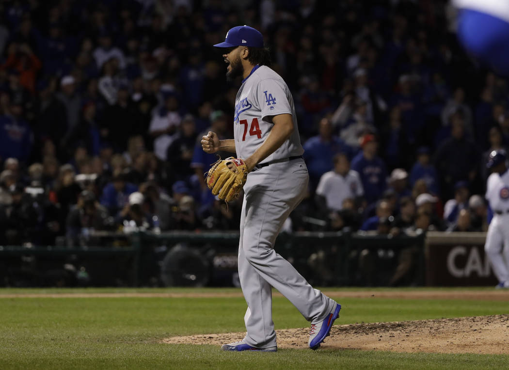 Los Angeles Dodgers relief pitcher Kenley Jansen (74) celebrates after Game 5 of baseball's National League Championship Series against the Chicago Cubs, Thursday, Oct. 19, 2017, in Chicago. The D ...