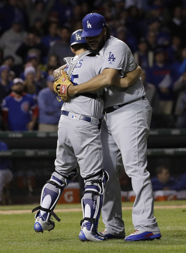 Los Angeles Dodgers' Austin Barnes, left, and Kenley Jansen celebrate after Game 5 of baseball's National League Championship Series against the Chicago Cubs, Thursday, Oct. 19, 2017, in Chicago.  ...
