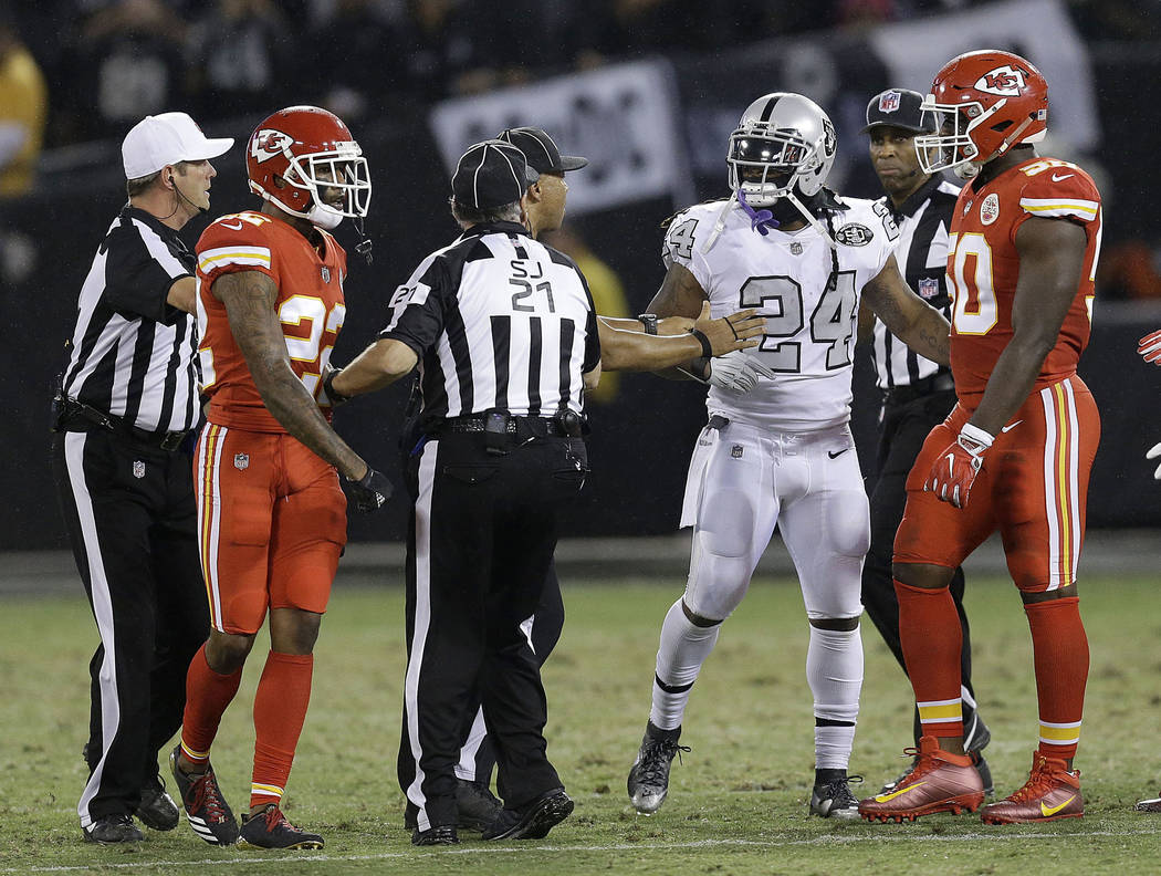 7319e3bb34a Oakland Raiders running back Marshawn Lynch (24) talks with officials  before he was ejected