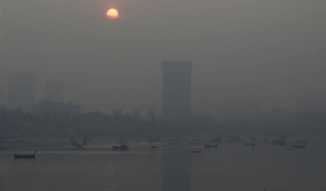 Morning smog envelops the skyline in Mumbai, India, Friday, Oct. 20, 2017. Environmental pollutants are killing at least 9 million people and costing the world $4.6 trillion a year, a toll exceedi ...