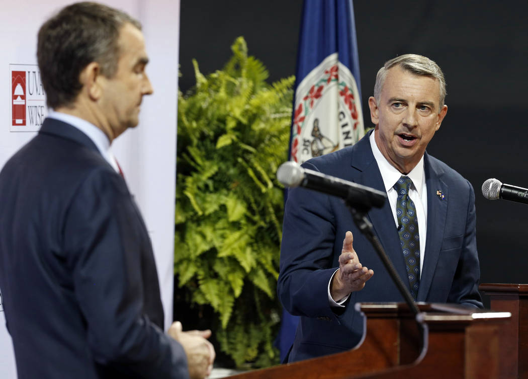 In this Oct. 9, 2016 file photo Republican gubernatorial candidate, Ed Gillespie, right, gesturing a debate with Democratic challenger Lt. Gov. Ralph Northam at University of Virginia-Wise in Wise ...