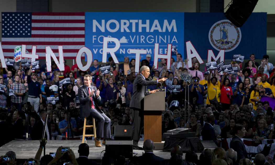 Former President Barack Obama, right, gestures during a rally with Virginia's Democratic gubernatorial candidate Lt. Gov. Ralph Northam, in Richmond, Va., Thursday, Oct. 19, 2017. (AP Photo/Steve  ...
