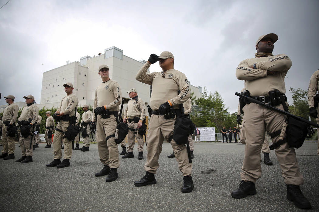 Troopers with the Florida Highway Patrol Quick Response Force line in front of the Phillips Center on the University of Florida campus in Gainesville ahead of white nationalist Richard Spencer's s ...