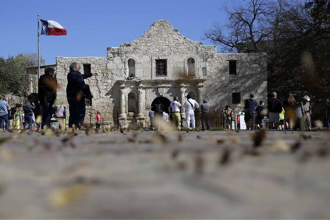 In this Feb. 23, 2016, file photo, guests visit the grounds of the Alamo in San Antonio. (Eric Gay/AP)