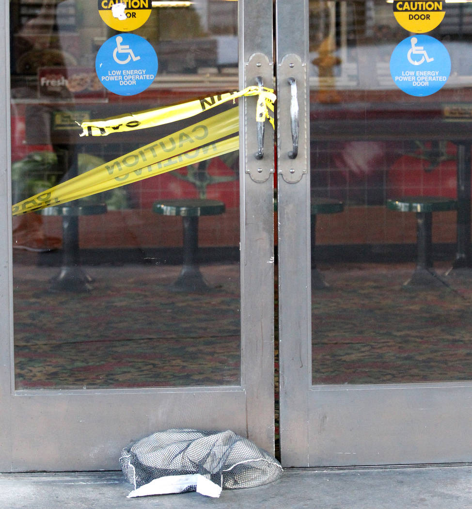 Doors to the Subway restaurant on the corner of East Ogden Avenue and North 6th Street inside the El Cortez are closed to prevent damage from high winds while the business remains open Friday, Oct ...