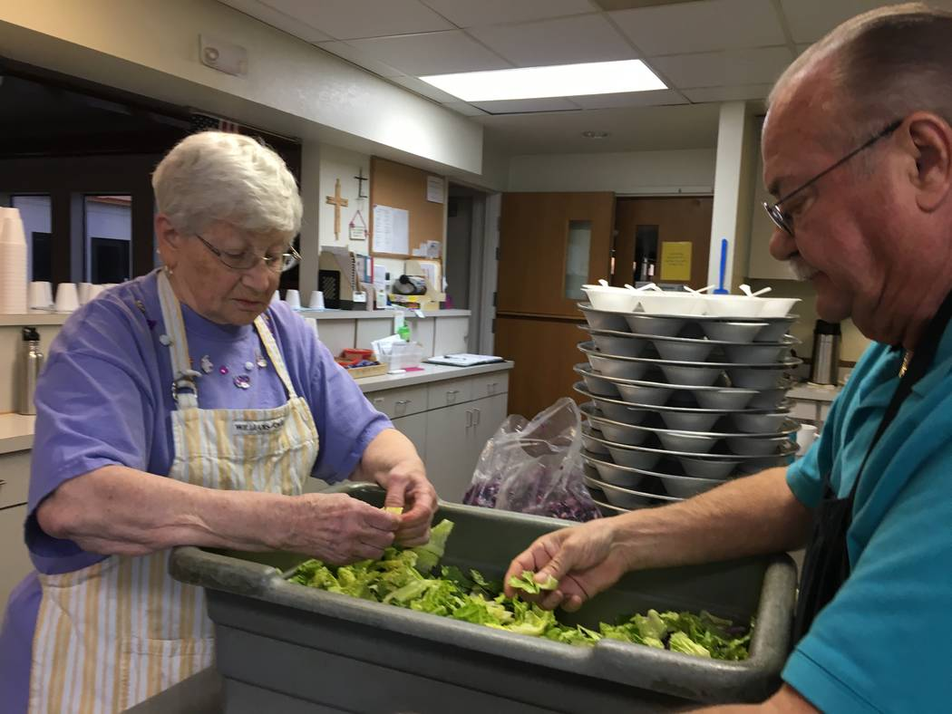 Muriel Dunfendach and volunteer Allan Howe prepare a salad for the night's meal on Oct. 18. (Diego Mendoza-Moyers/View) @dmendozamoyers