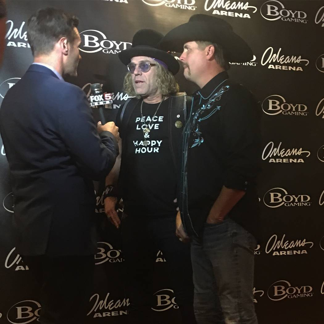 """""""Big Kenny"""" Alphin, middle, and John Rich of Big & Rich are interviewed by Fox 5's Sean McAllister before """"Vegas Strong: A Night of Healing"""" at the Orleans Arena on Thursday, Oct. 19, 2017. (J ..."""
