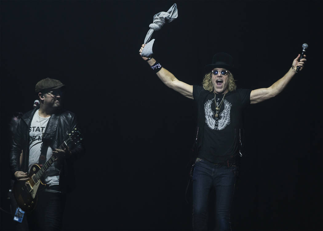 """Big & Rich perform during """"Vegas Strong: A Night of Healing,"""" a benefit concert for the Oct.1 shooting on the Las Vegas Strip, Thursday, Oct. 19, 2017, at the Orleans Arena, in Las Vegas. (Ben ..."""