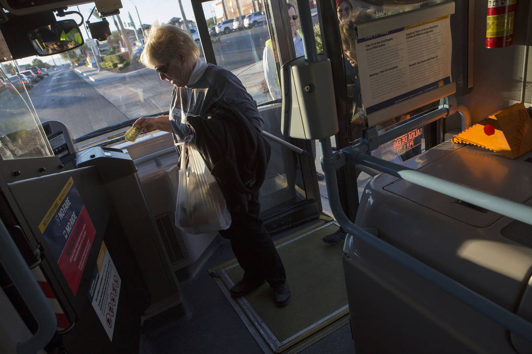 Suzanne Buchman boards an express bus at South Eastern Avenue and East Pebble Road in Henderson to take her to T-Mobile Arena in Las Vegas for the Vegas Golden Knights game on Tuesday, Oct. 24, 20 ...