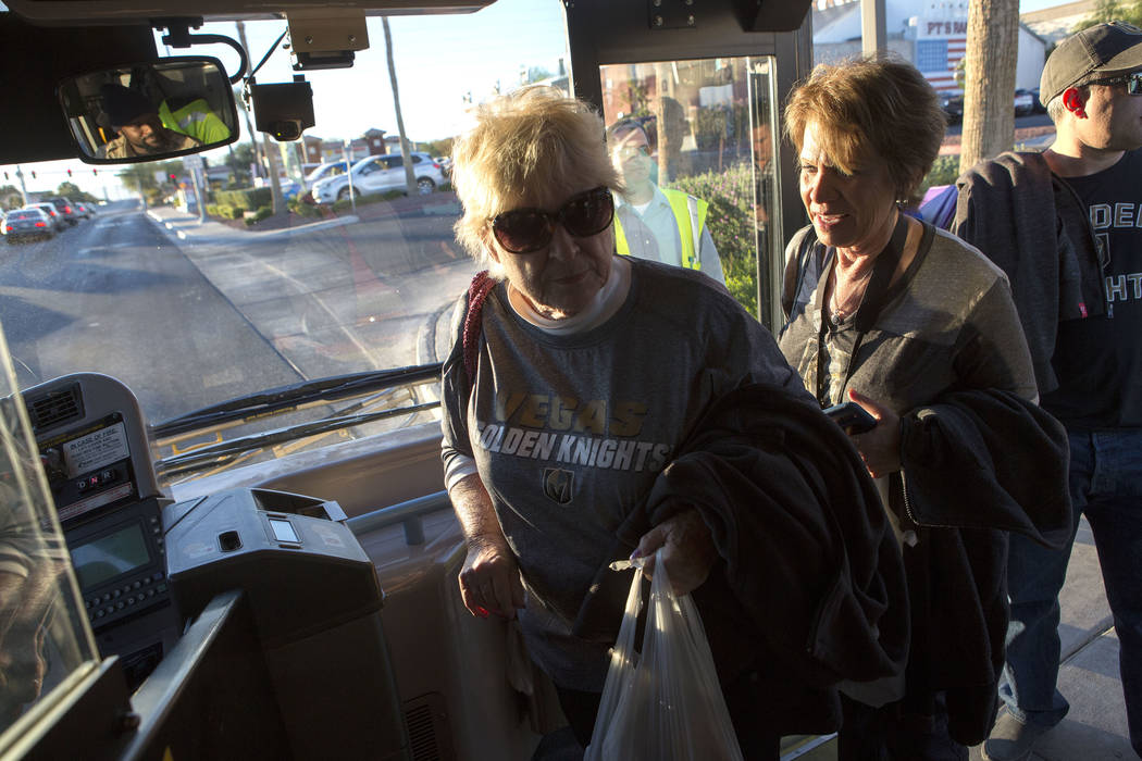 Suzanne Buchman, left and Caryn Dibble board an express bus at South Eastern Avenue and East Pebble Road in Henderson to take them to T-Mobile Arena in Las Vegas for the Vegas Golden Knights game  ...