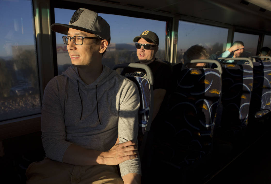 Phillip Buche, left, rides the express bus from South Eastern Avenue and East Pebble Road in Henderson to T-Mobile Arena in Las Vegas for the Vegas Golden Knights game on Tuesday, Oct. 24, 2017. B ...