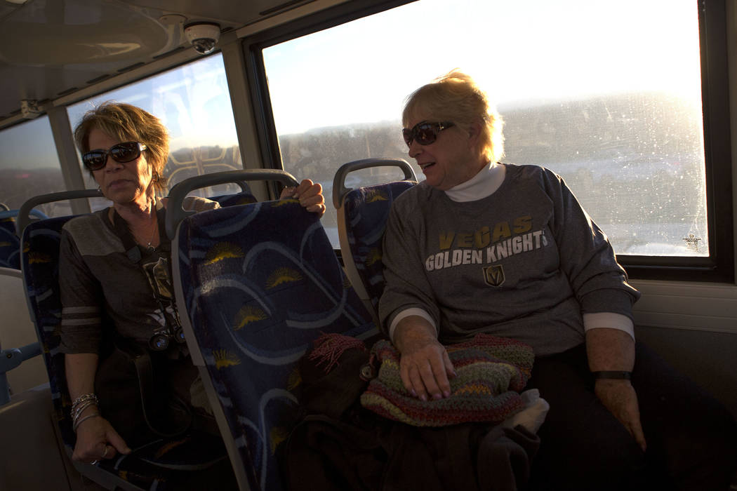Caryn Dibble, left, and Suzanne Buchman ride an express bus from South Eastern Avenue and East Pebble Road in Henderson to T-Mobile Arena in Las Vegas for the Vegas Golden Knights game on Tuesday, ...