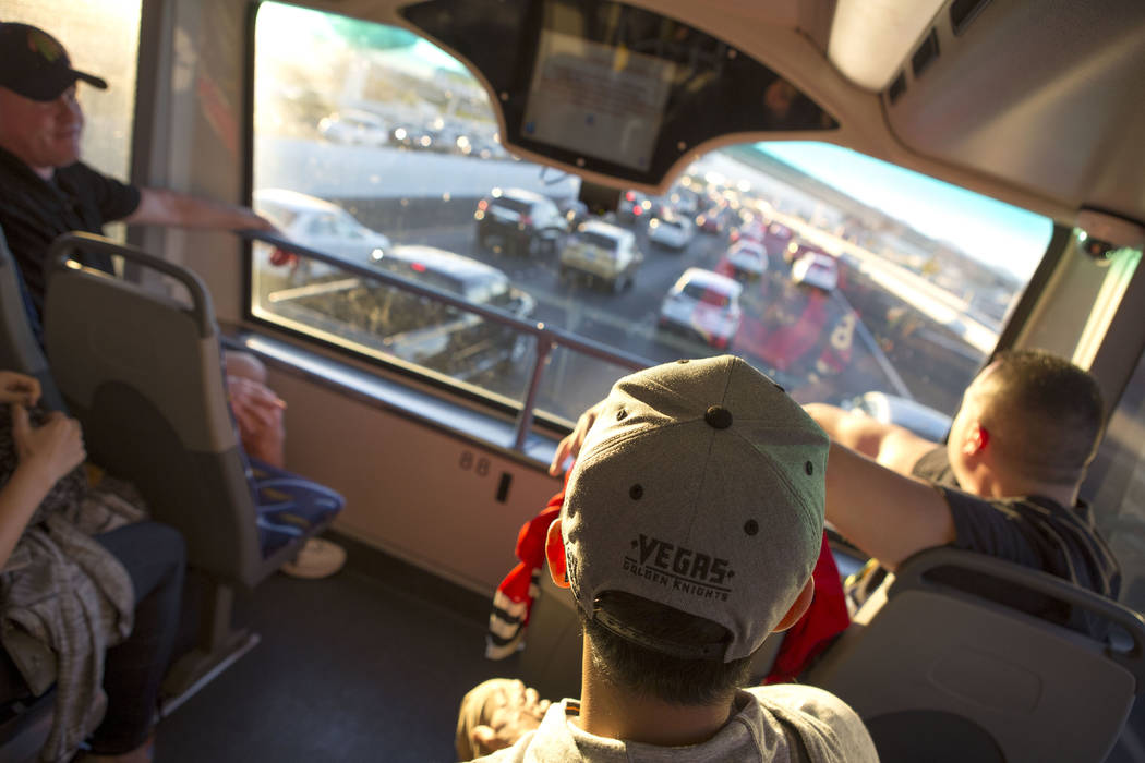 Phillip Buche sports a Vegas Golden Knights hat while he rides the express bus from South Eastern Avenue and East Pebble Road in Henderson to T-Mobile Arena in Las Vegas for the Vegas Golden Knigh ...