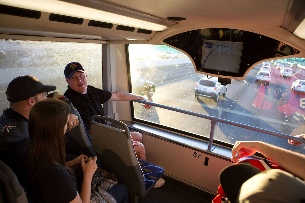 Hockey fans ride the express bus from South Eastern Avenue and East Pebble Road in Henderson to T-Mobile Arena in Las Vegas for the Vegas Golden Knights game on Tuesday, Oct. 24, 2017. Bridget Ben ...