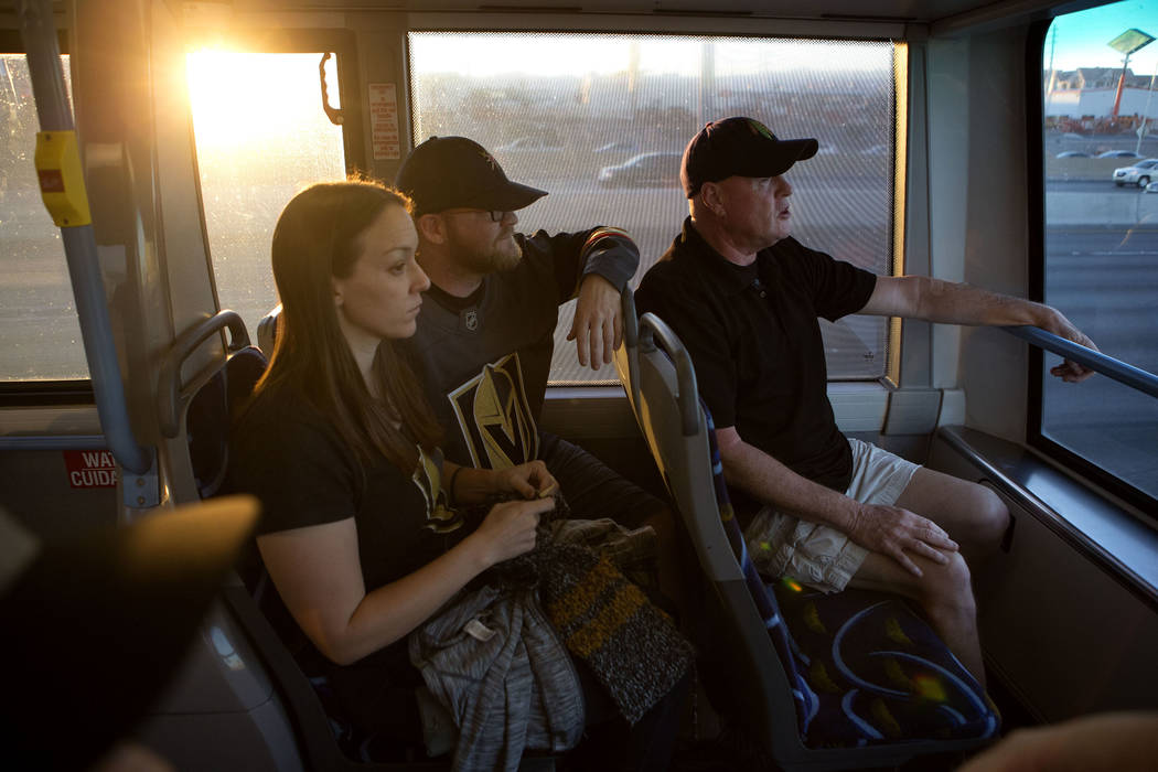 Hockey fans Trish Harrison, left, her husband Russ Harrison and Bill Smith ride an express bus in route to T-Mobile Arena in Las Vegas for the Vegas Golden Knights game on Tuesday, Oct. 24, 2017.  ...