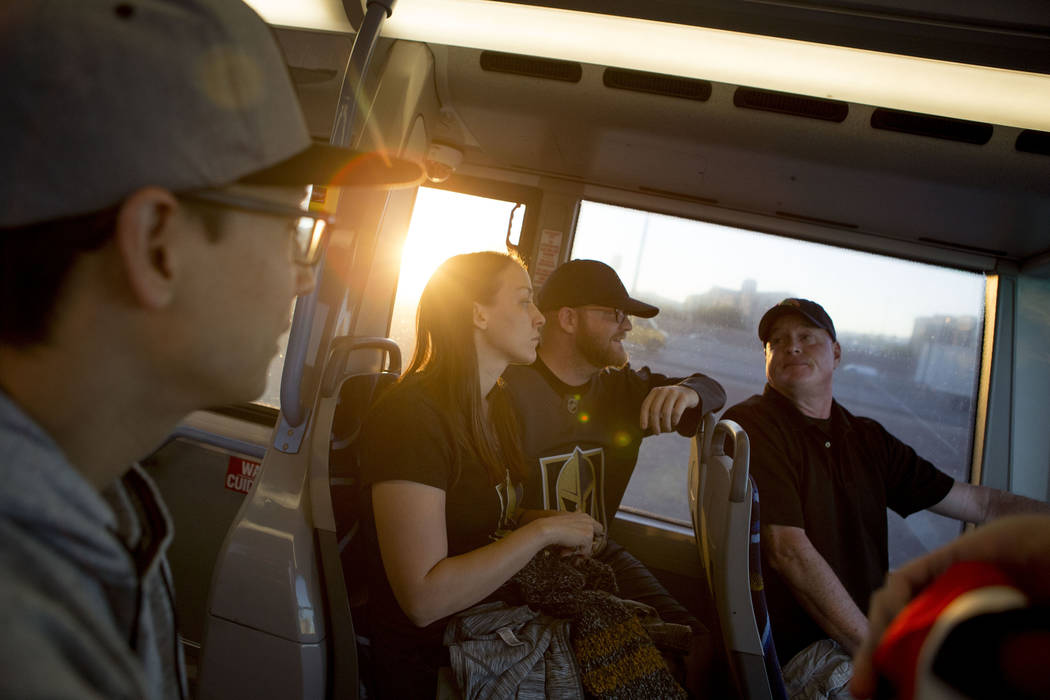 Hockey fans Phillip Busche, left, Trish Harrison, Russ Harrison and Bill Smith ride an express bus in route to T-Mobile Arena in Las Vegas for the Vegas Golden Knights game on Tuesday, Oct. 24, 20 ...