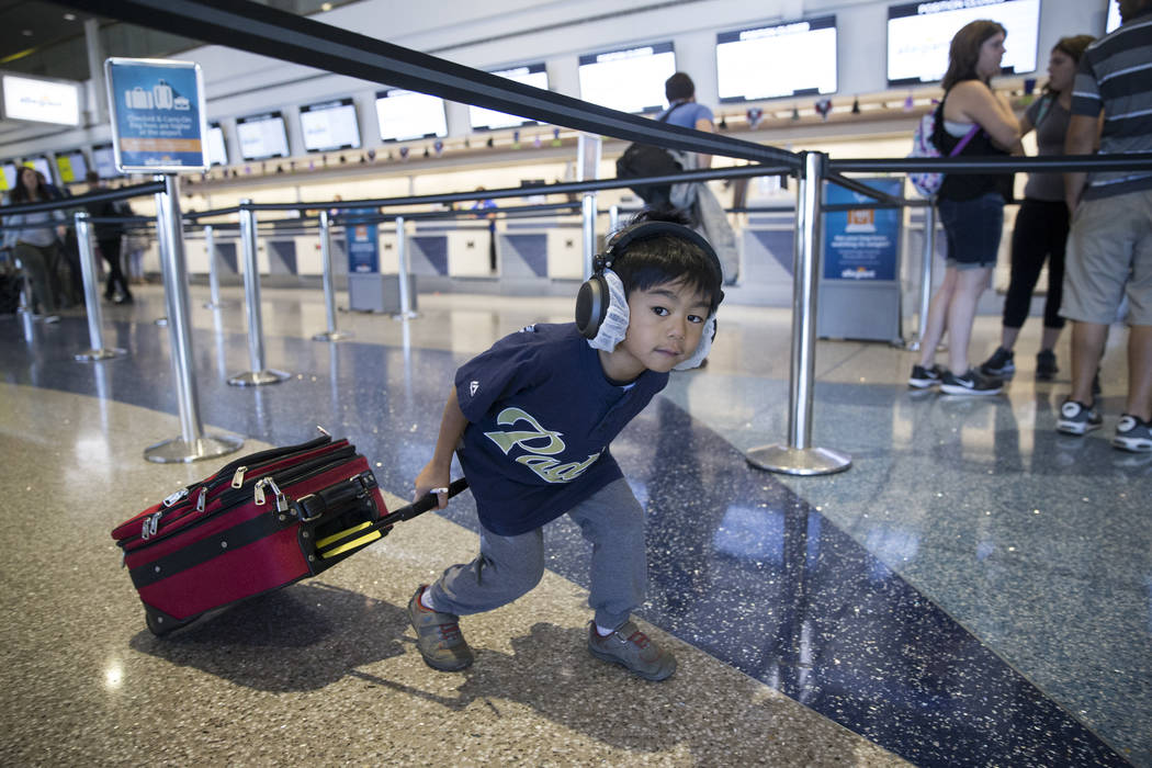 Analu Tam, 6, of Las Vegas, walks to the Allegiant ticketing desk during the Wings for Autism event at McCarran International Airport in Las Vegas, Saturday, Oct. 21, 2017. Erik Verduzco Las Vegas ...