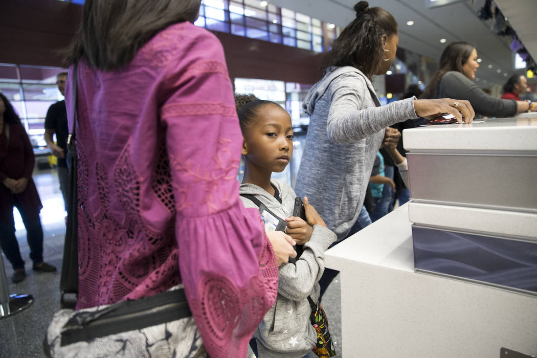 Malia Neal, 7, of Las Vegas, waits in the Allegiant ticketing desk during the Wings for Autism event at McCarran International Airport in Las Vegas, Saturday, Oct. 21, 2017. Erik Verduzco Las Vega ...