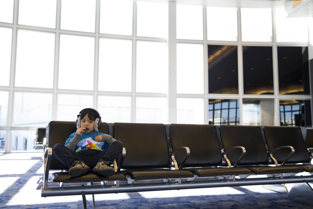 Kailana Tam, 8, of Las Vegas, waits to board an Allegiant plane during the Wings for Autism event at McCarran International Airport in Las Vegas, Saturday, Oct. 21, 2017. Erik Verduzco Las Vegas R ...