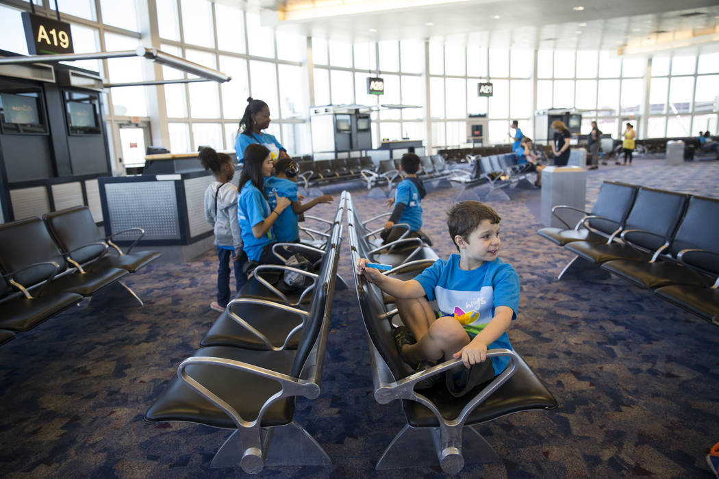 Kevin DerOhanian, 9, of Las Vegas, waits to board an Allegiant plane during the Wings for Autism event at McCarran International Airport in Las Vegas, Saturday, Oct. 21, 2017. Erik Verduzco Las Ve ...