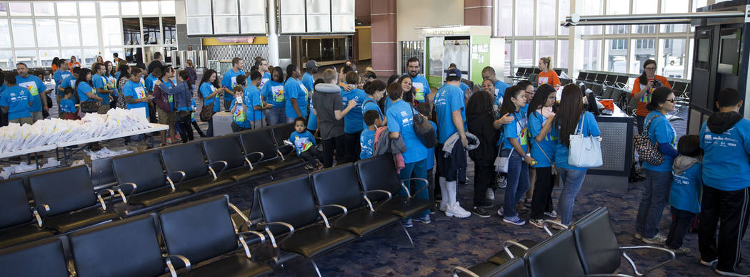 People wait to board an Allegiant plane during the Wings for Autism event at McCarran International Airport in Las Vegas, Saturday, Oct. 21, 2017. Erik Verduzco Las Vegas Review-Journal @Erik_Verduzco