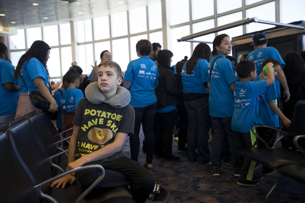 Lucas Reisman, 13, of Las Vegas, waits to board an Allegiant plane during the Wings for Autism event at McCarran International Airport in Las Vegas, Saturday, Oct. 21, 2017. Erik Verduzco Las Vega ...