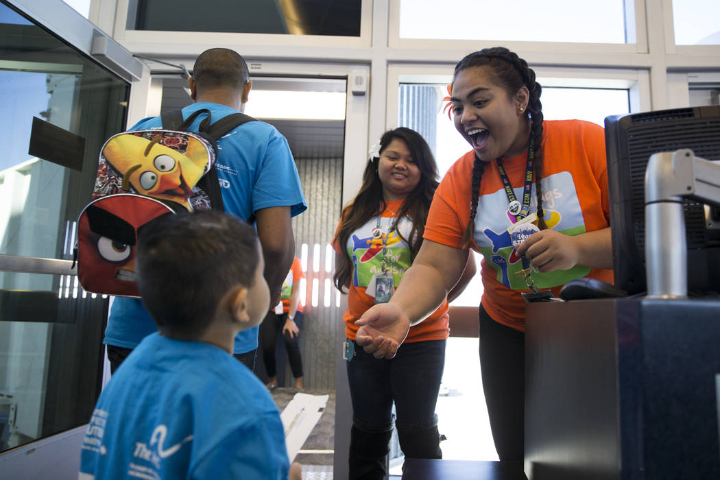 Allegiant Gate Agent Brenda Osa collects boarding passes during the Wings for Autism event at McCarran International Airport in Las Vegas, Saturday, Oct. 21, 2017. Erik Verduzco Las Vegas Review-J ...