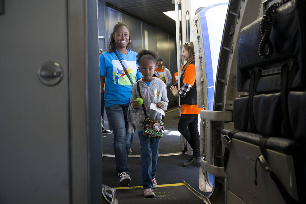 Andrea Neal with her daughter Malia, 7, of Las Vegas, board an Allegiant plane during the Wings for Autism event at McCarran International Airport in Las Vegas, Saturday, Oct. 21, 2017. Erik Verdu ...