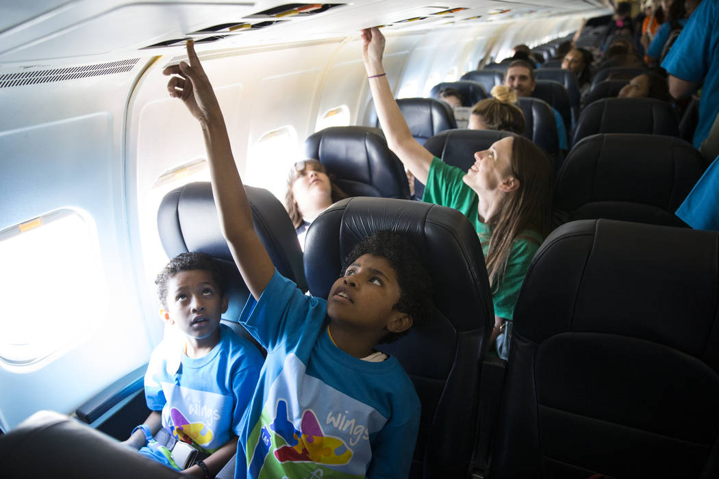 Romeo Knox, 9, from left, and his brother Roman, 11, inside an Allegiant plane during the Wings for Autism event at McCarran International Airport in Las Vegas, Saturday, Oct. 21, 2017. Erik Verdu ...