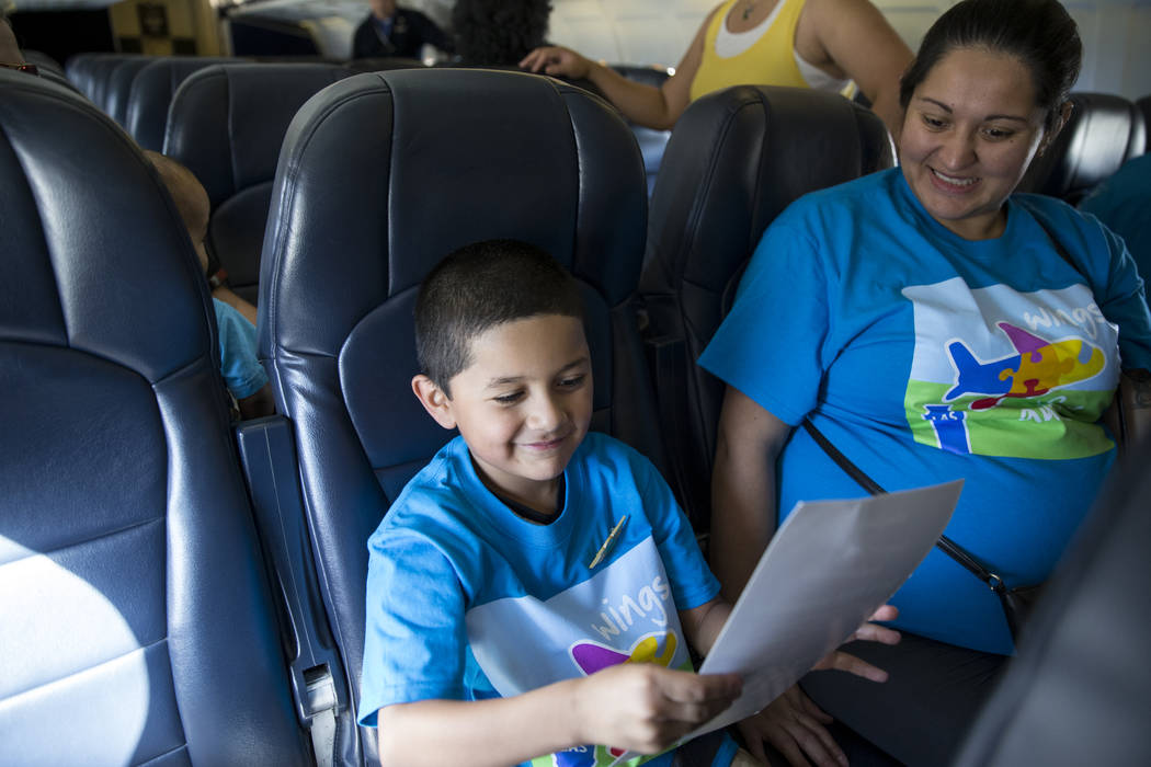 King Sanchez, 5, with his mother Donata Solano, on board of an Allegiant plane during the Wings for Autism event at McCarran International Airport in Las Vegas, Saturday, Oct. 21, 2017. Erik Verdu ...