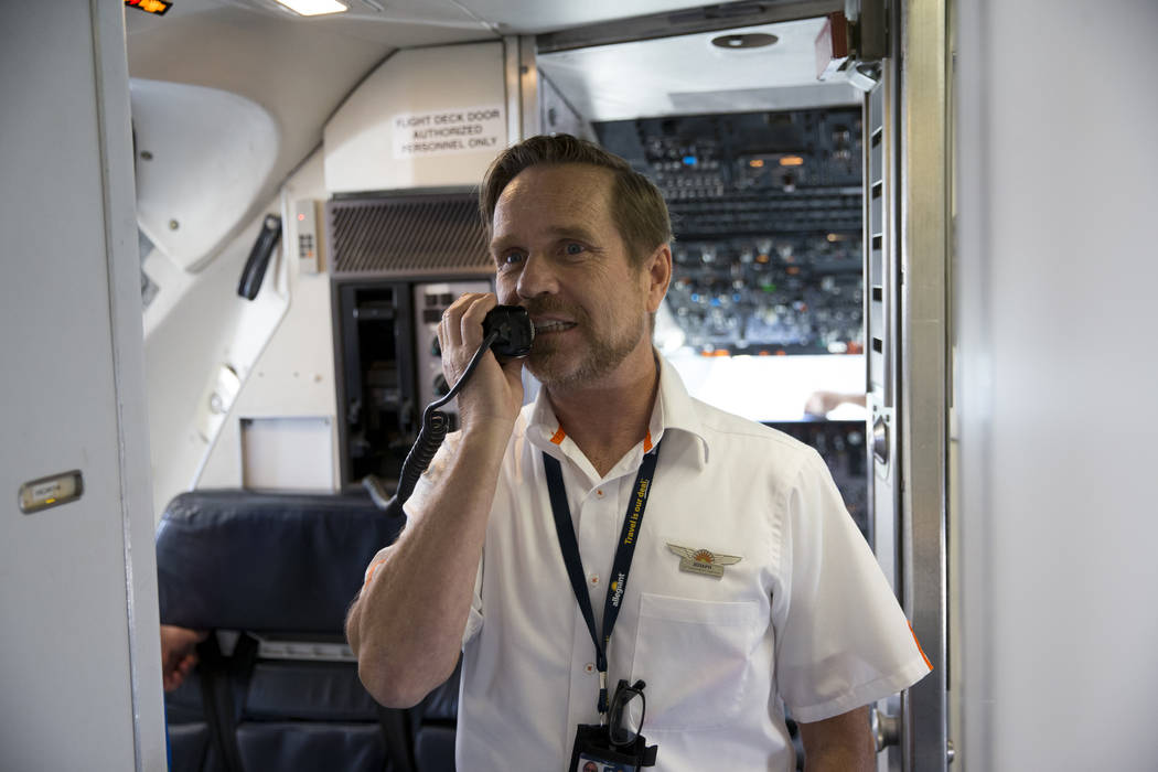 Flight Attendant Joe Mayfield gives instructions on board of an Allegiant plane during the Wings for Autism event at McCarran International Airport in Las Vegas, Saturday, Oct. 21, 2017. Erik Verd ...