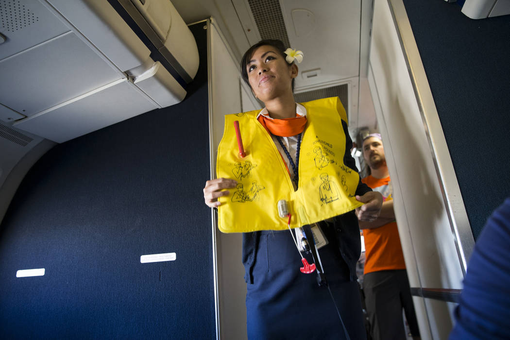 Flight Attendant Jessica Tan gives instructions on board of an Allegiant plane during the Wings for Autism event at McCarran International Airport in Las Vegas, Saturday, Oct. 21, 2017. Erik Verdu ...