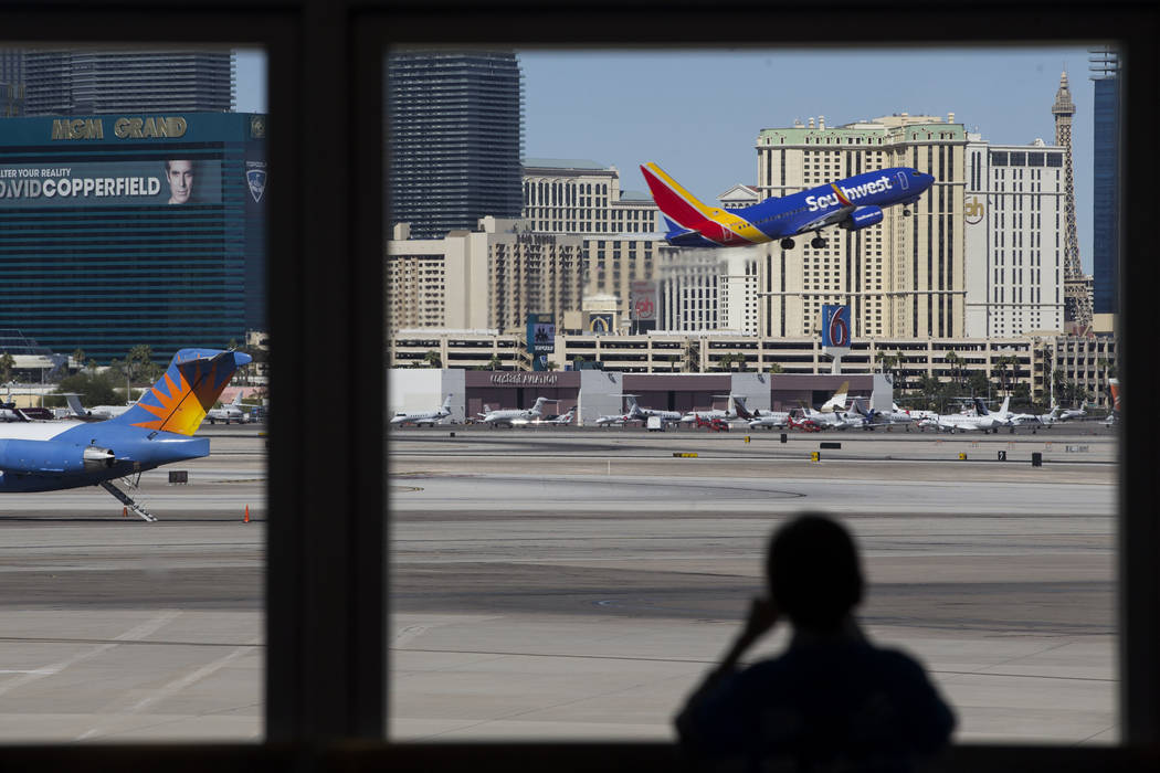 A silhouetted child watches as plane takes the air from McCarran International Airport in Las Vegas during the Wings for Autism event, Saturday, Oct. 21, 2017. Erik Verduzco Las Vegas Review-Journ ...